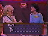 Betty White helps her partner spell 'OUBLE TALK'