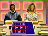 Ted Lange and a contestant face off