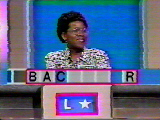 A contestant tries to solve a word